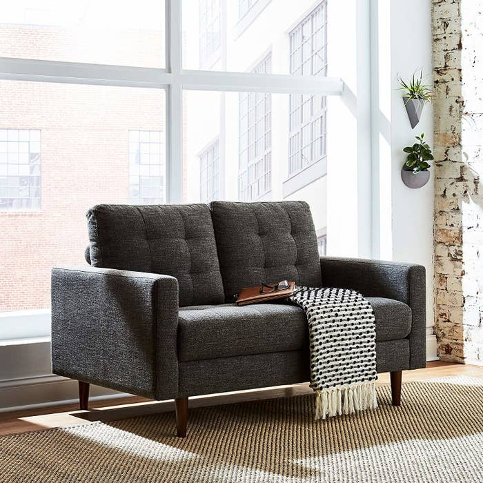 Get it from Amazon for $599.99+ (also available in a lighter gray and as a couch).And be sure check out our guide on the best places to buy a sofa online.