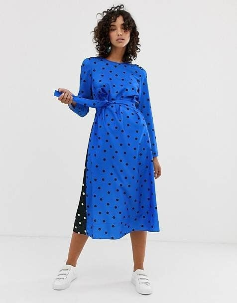 a06dae73284fe A long sleeve polka dot midi dress with a tie waist and attention-grabbing  color blocking making it the perfect addition to your work wardrobe.