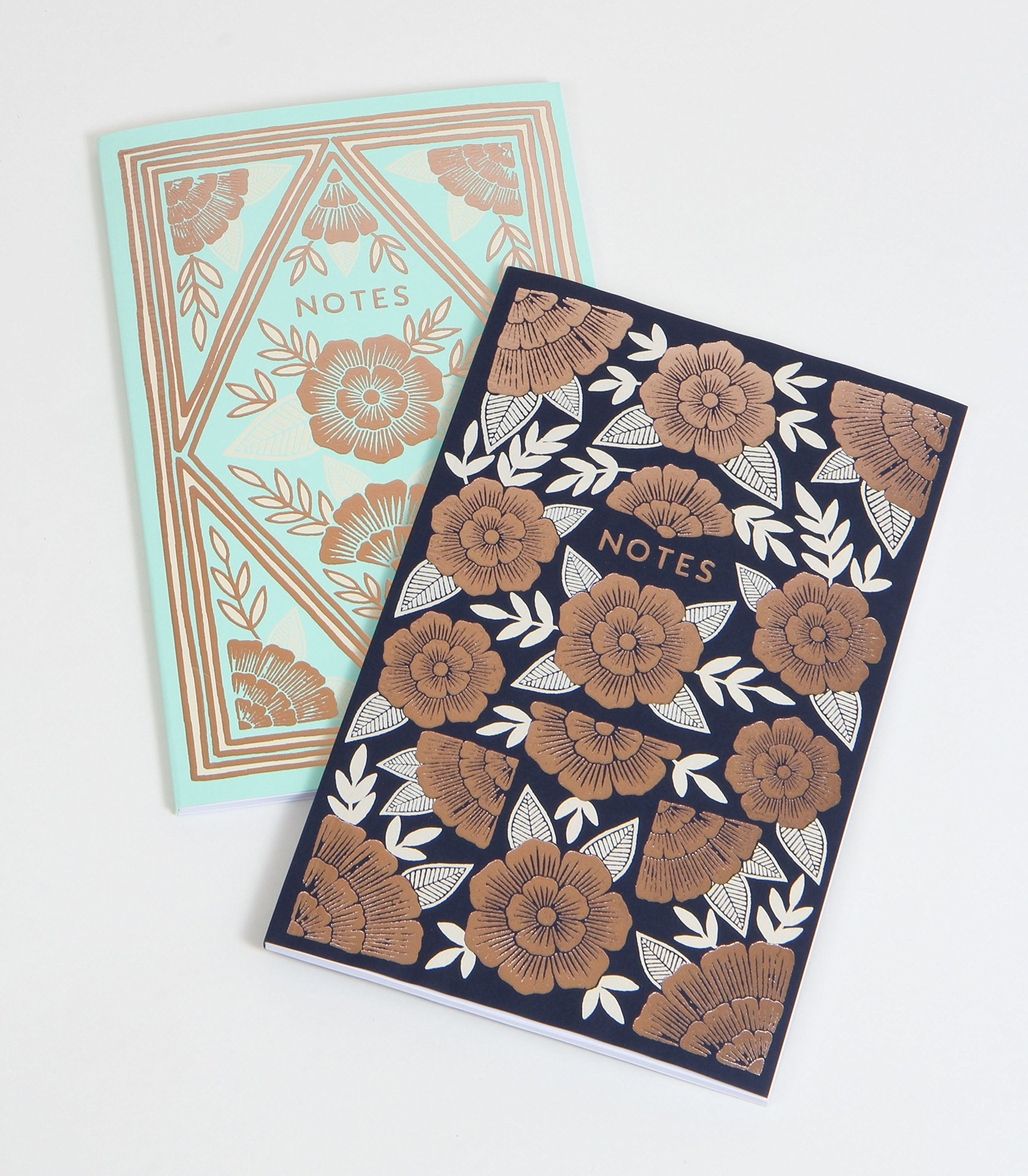 """two notebooks with flowers on the cover that say """"notes"""""""