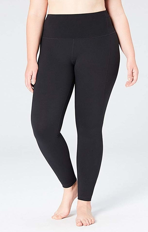 Plus-size model wearing black high-rise leggings