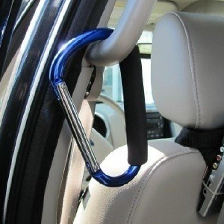 carabiner hooked to handle in a minivan