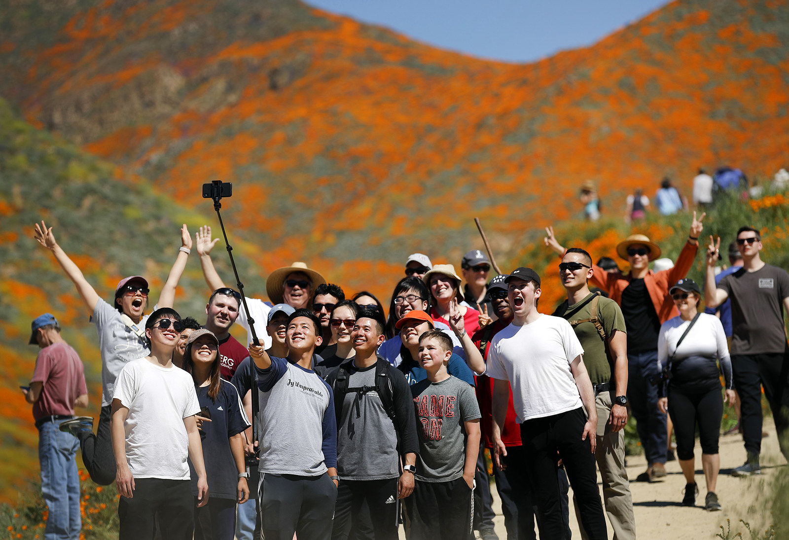People pose for a picture among the blooming wildflowers, March 18.