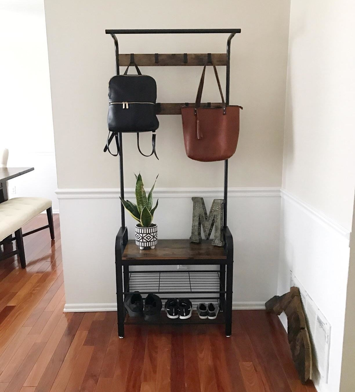 Reviewer image showing the rack in use, with coat hooks on top and a shoe rack on the bottom