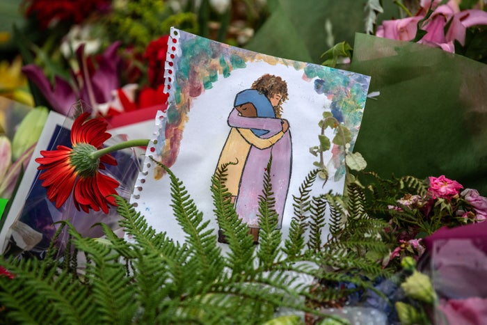 Artwork is left among flowers and tributes near Al Noor mosque on March 18 in Christchurch.
