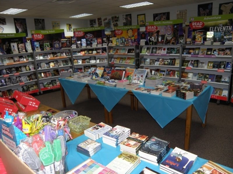 A elementary school library set up for Scholastic Book Fair day.