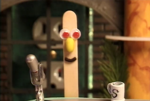 Photo of Stick Stickly at his desk