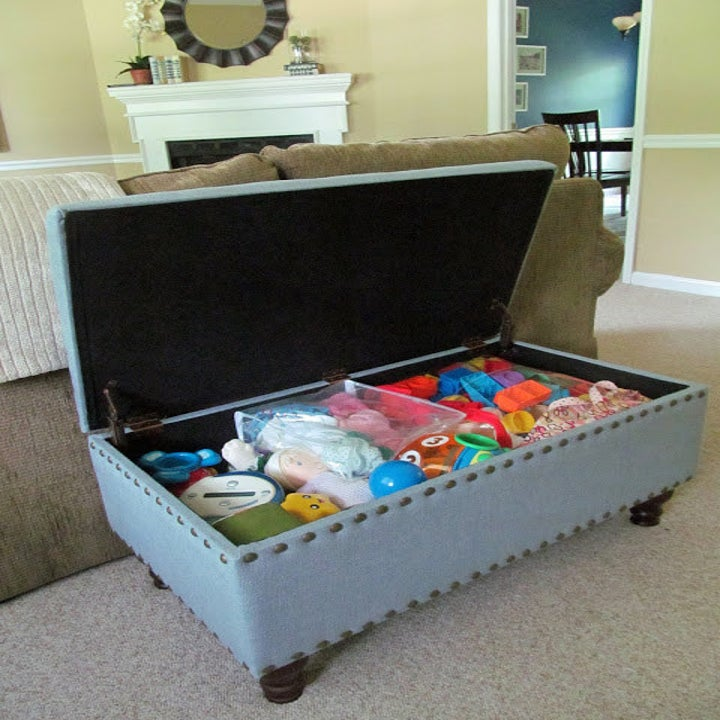 blogger's blue ottoman filled with kids toys