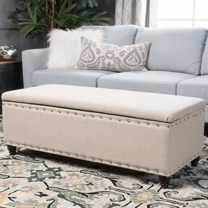 white storage ottoman with rivets