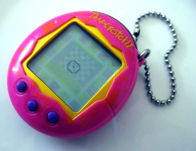 Photo of a hot pink Tamagotchi on a table