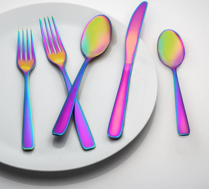 """The dishwasher-safe set includes four teaspoons, four soup spoons, four dinner forks, four salad forks, and four dinner knives.Promising review: """"What a fun set! The iridescent colors will make any boring dinner table pop with personality. The set is well-made, has a nice sturdy weight, and is such a good deal for a 20-piece set."""" —SFShopper Aud Price: $27.94"""
