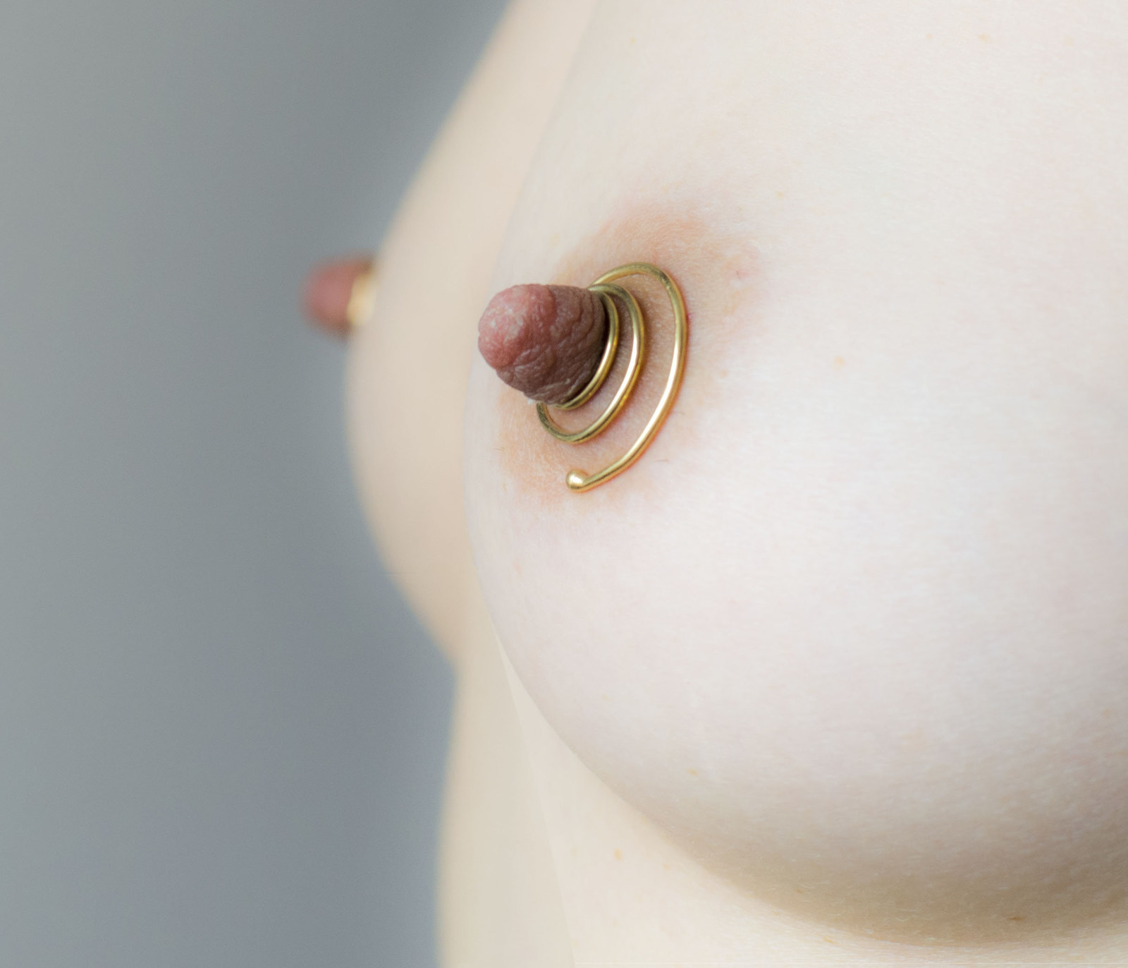 gold spiral circles on nipples