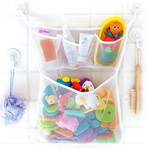 bag with one large pocket on bottom fitting dozens of smaller toys, and three smaller pockets on top that fit soaps and lotions