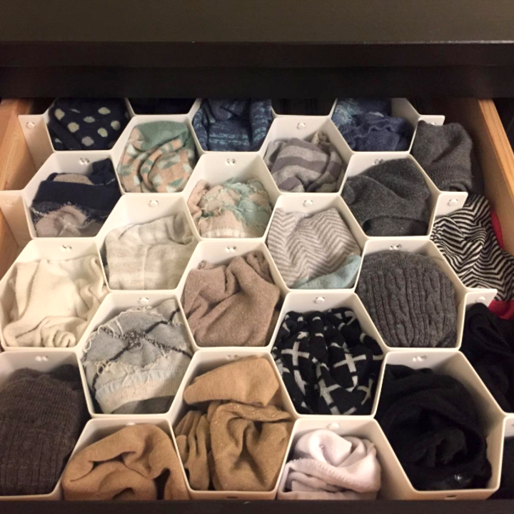 after: the same drawer, each pair tucked into its own honeycomb slot