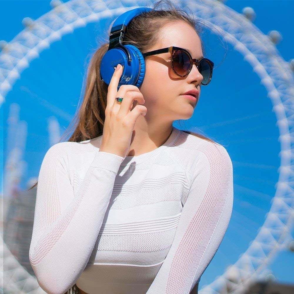 a model using the headphones in blue