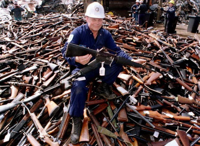 Project supervisor Norm Legg holds a gun during the Australian buyback in 1996.