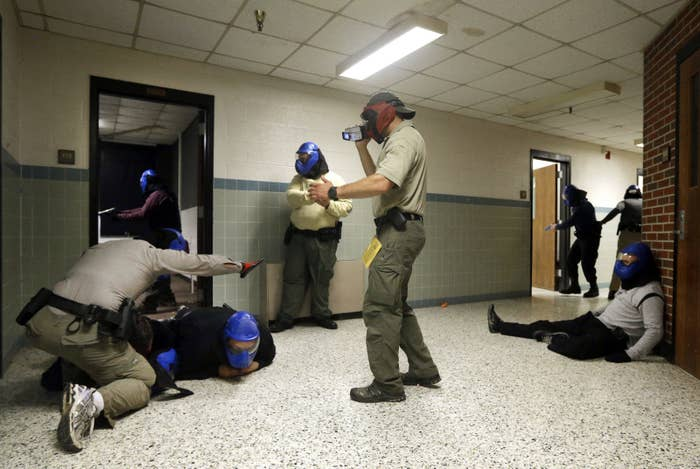Police officers participate in an active shooter drill in a classroom in Salisbury, Maryland, in 2013.