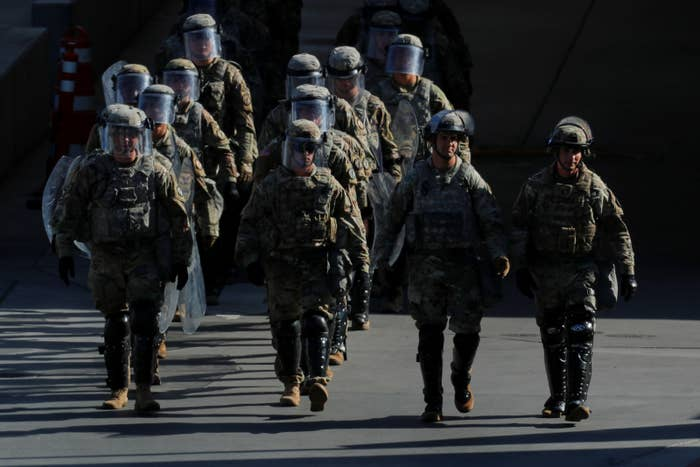 US military troops return from a test deployment along the US–Mexico border.