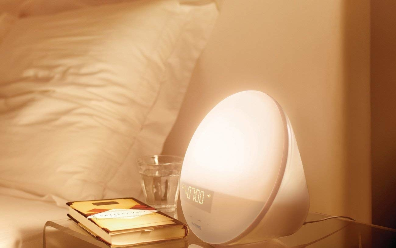 A wakeup light turning on on bedside table