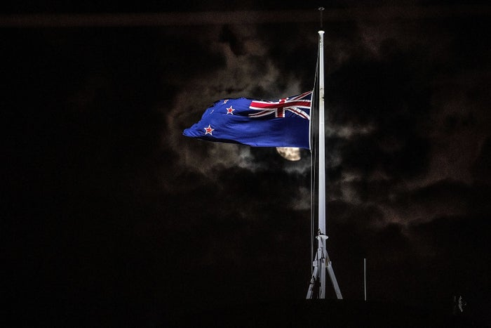 The New Zealand flag is flown at half-mast on a Parliament building in Wellington after the Christchurch attacks.