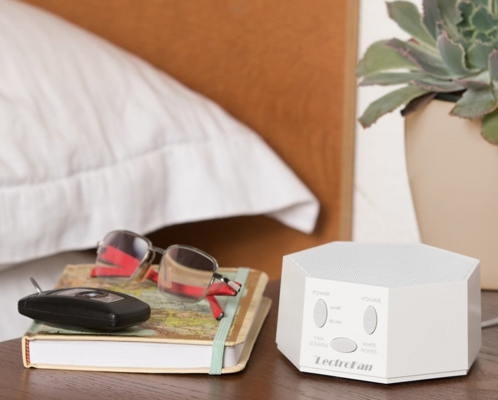 the white noise machine on an end table