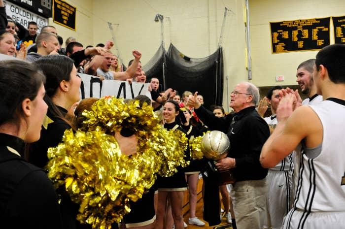 Mahanoy Area High School cheerleaders celebrate a boys' basketball team win.