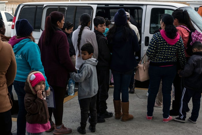 Asylum-seekers wait to be transported to the United States.