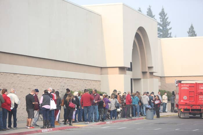 Survivors of the Camp fire wait in line to speak with FEMA representatives.