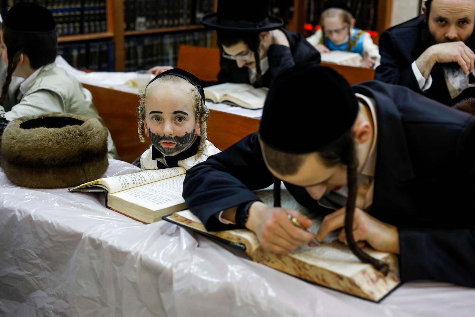 Ultra-Orthodox Jews study during the feast of Purim at a synagogue in Bnei Brak, Israel, on March 20.