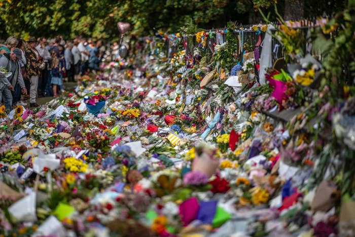 People view flowers and tributes in Christchurch, New Zealand, on March 19.