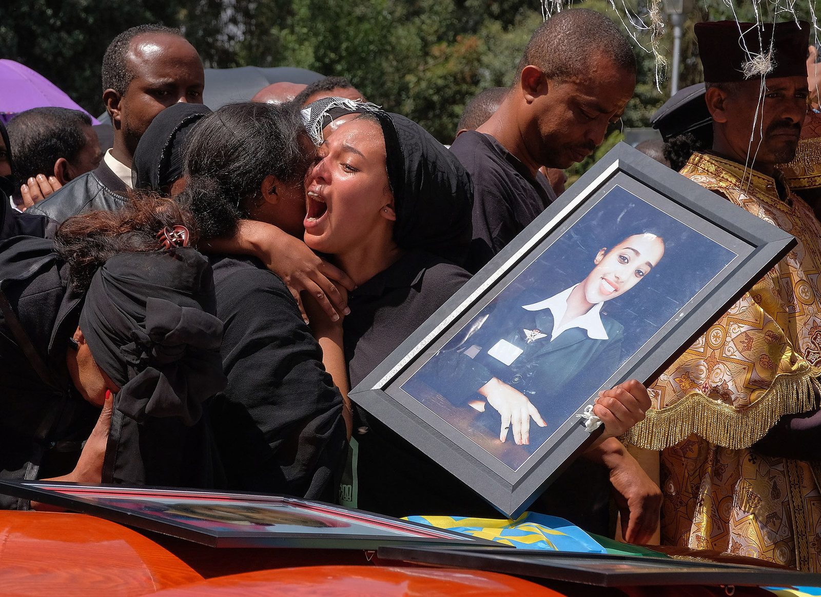 In this March 17 picture, woman cries over the coffin of a loved one during a memorial service for the Ethiopian passengers and crew who perished in the Ethiopian Airways ET302 crash.