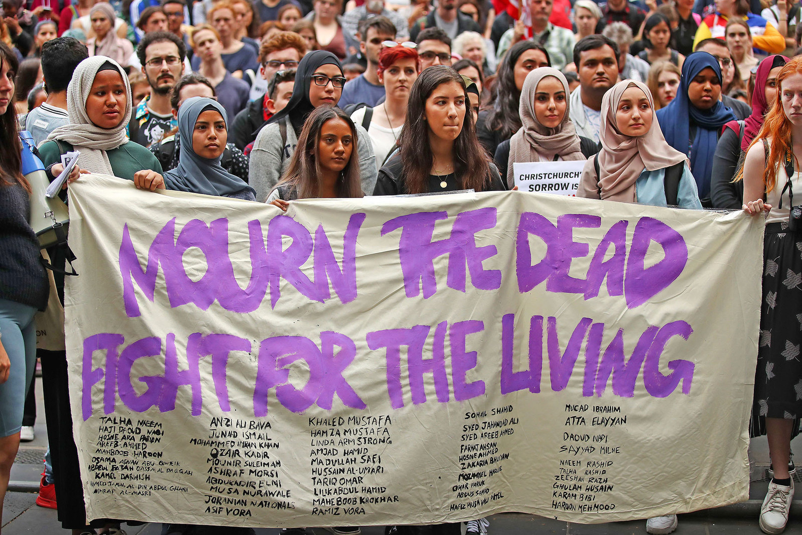 Protesters hold signs as they march during the Stand Against Racism and Islamophobia rally on March 19, in Melbourne, Australia.