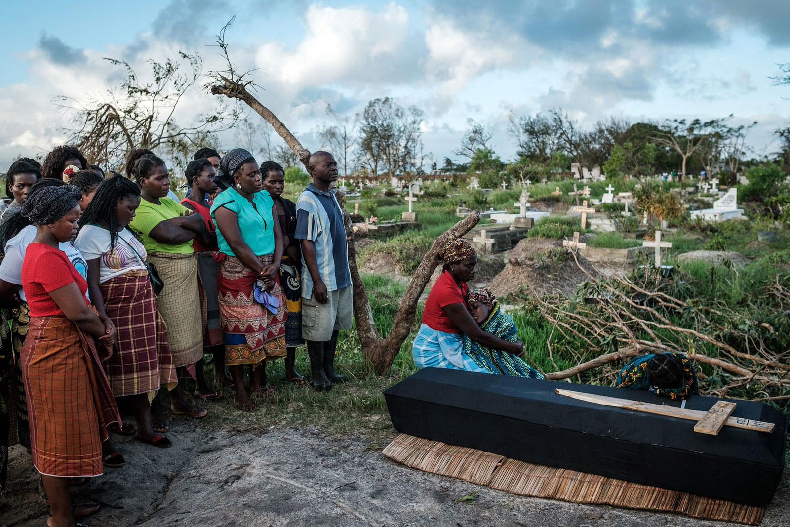 A woman mourns beside the coffin of her husband following a strong cyclone that hit Beira, Mozambique, on March 20.