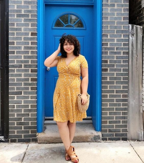Reviewer wearing the short-sleeve dress in yellow