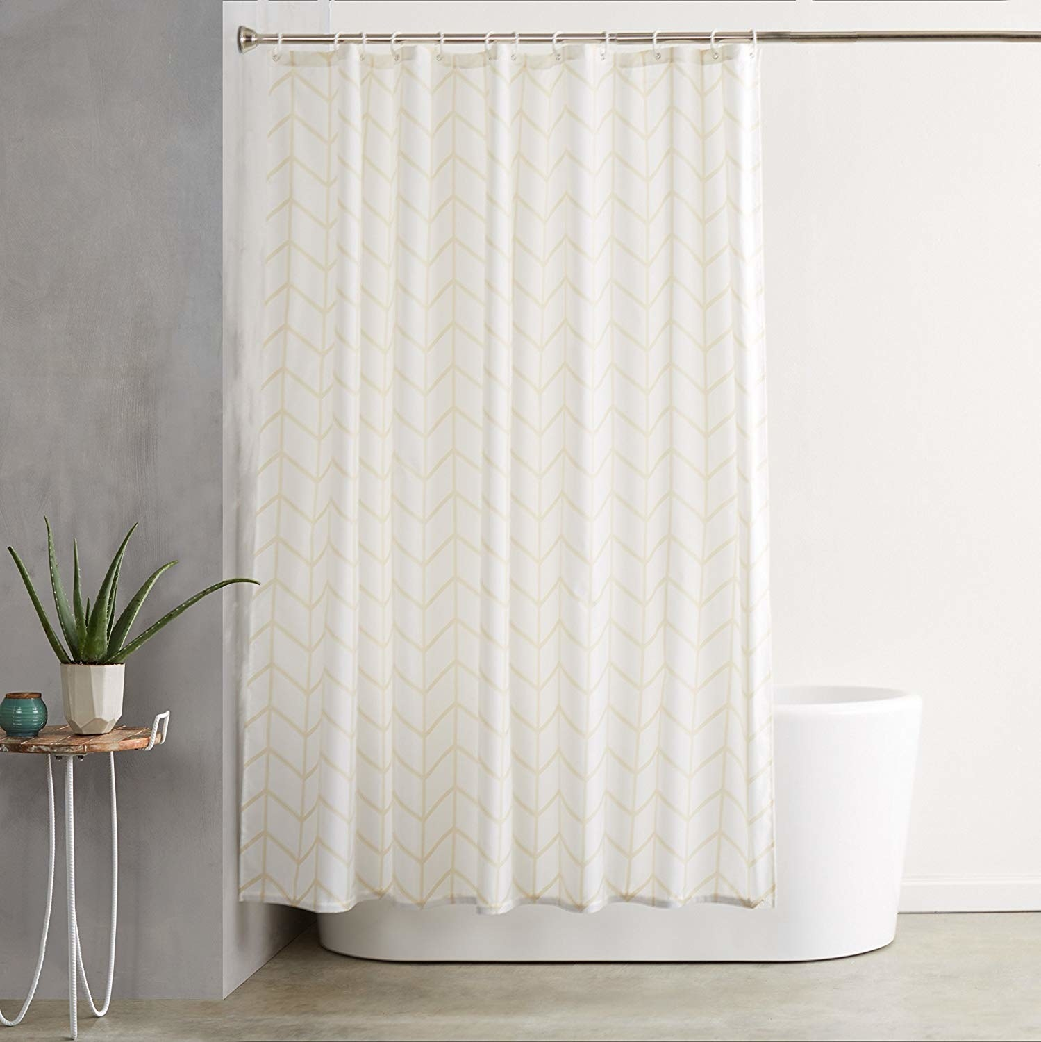 a white shower curtain with a yellow chevron design on it