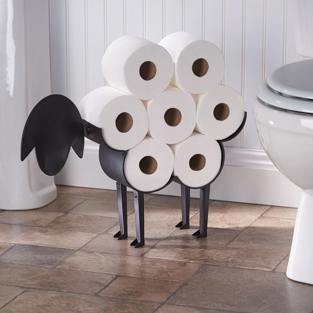 a toilet paper roll holder designed to look like a sheep
