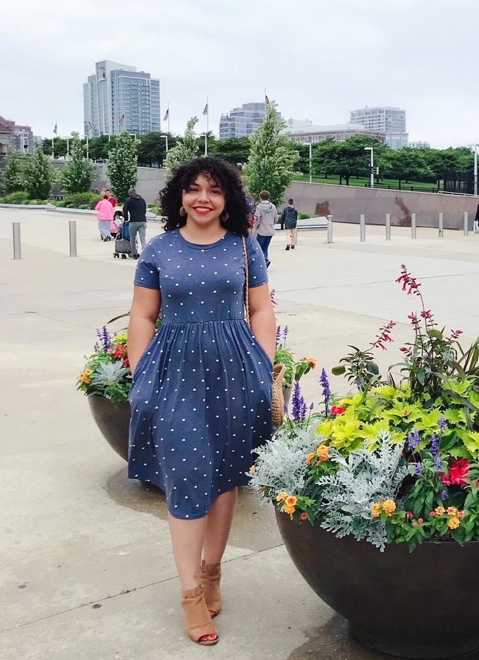 reviewer wears dress with white polka dot
