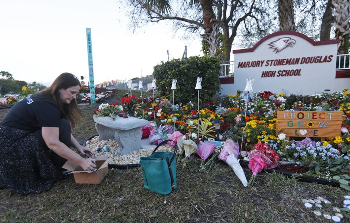 Suzanne Devine Clark at a memorial outside Marjory Stoneman Douglas High School during the one-year anniversary of the school shooting.