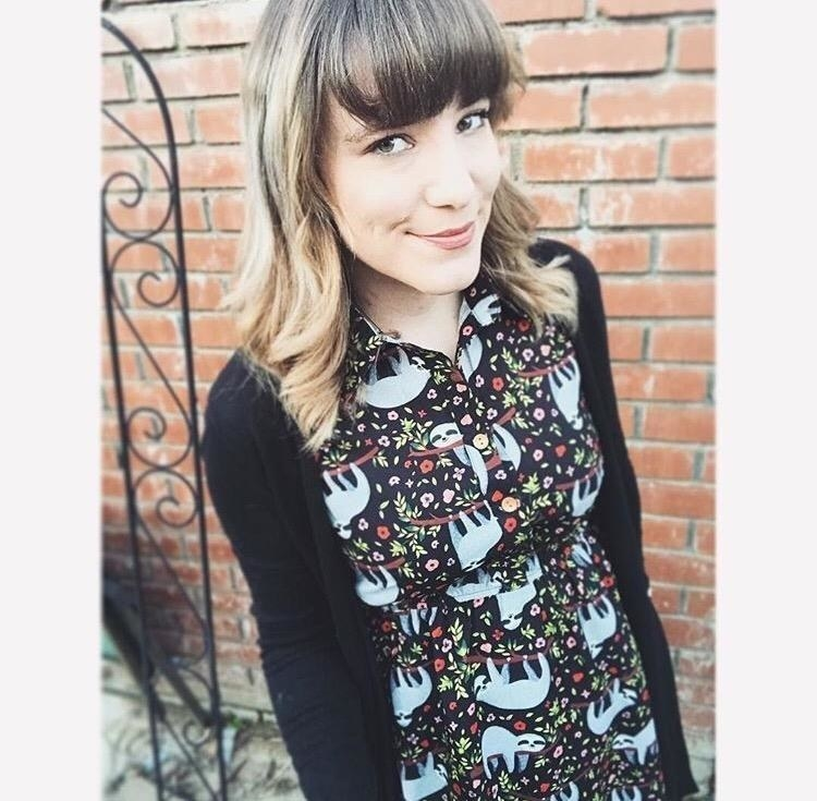 reviewers wears sloth dress with collar under a cardigan