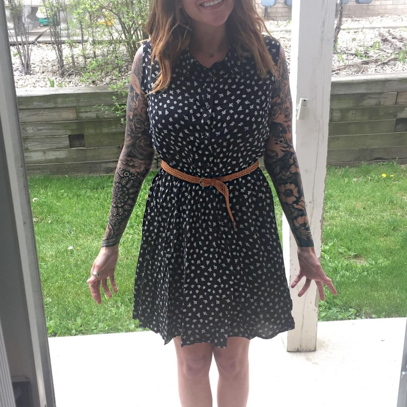 reviewer wears short sleeve dress with cat pattern