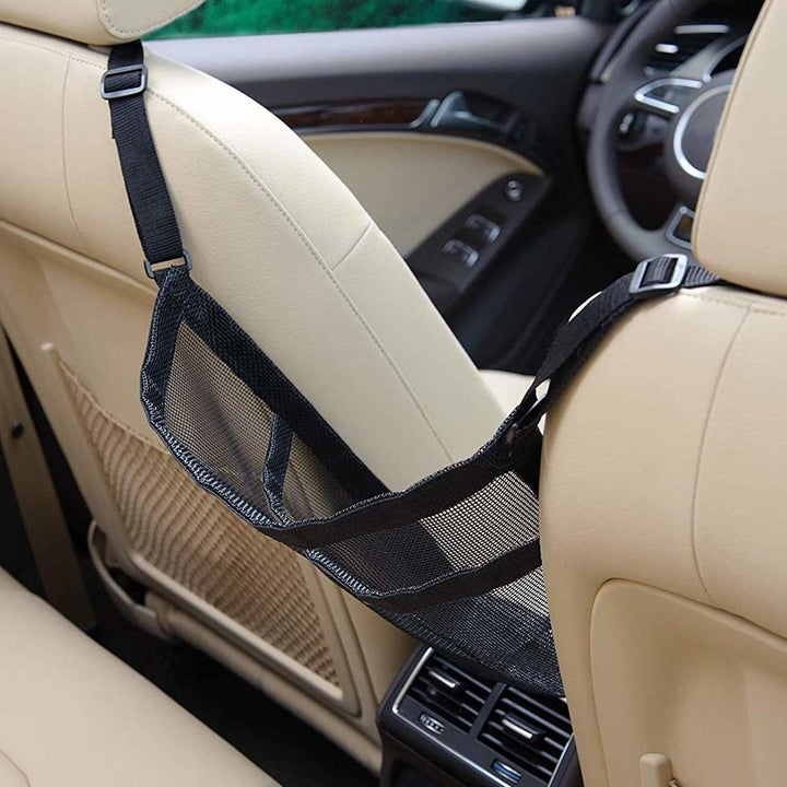 back view of empty sling for purse between front two car seats