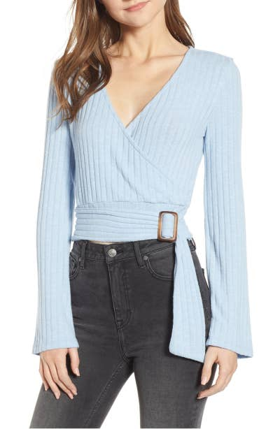 d4b3a3c717 A belted wrap top so you can look  très chic  even when pairing it with  your usual blue jeans. Who knew looking polished could always feel so comfy