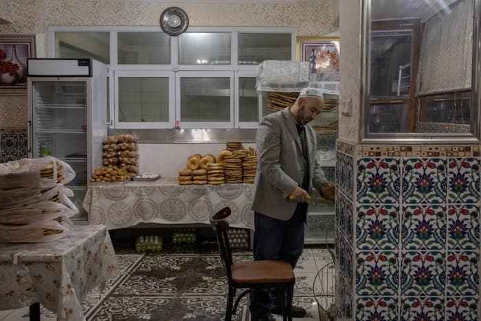 A baker prepares bread for display in a Uighur bakery in the Zeytinburnu district of Istanbul.