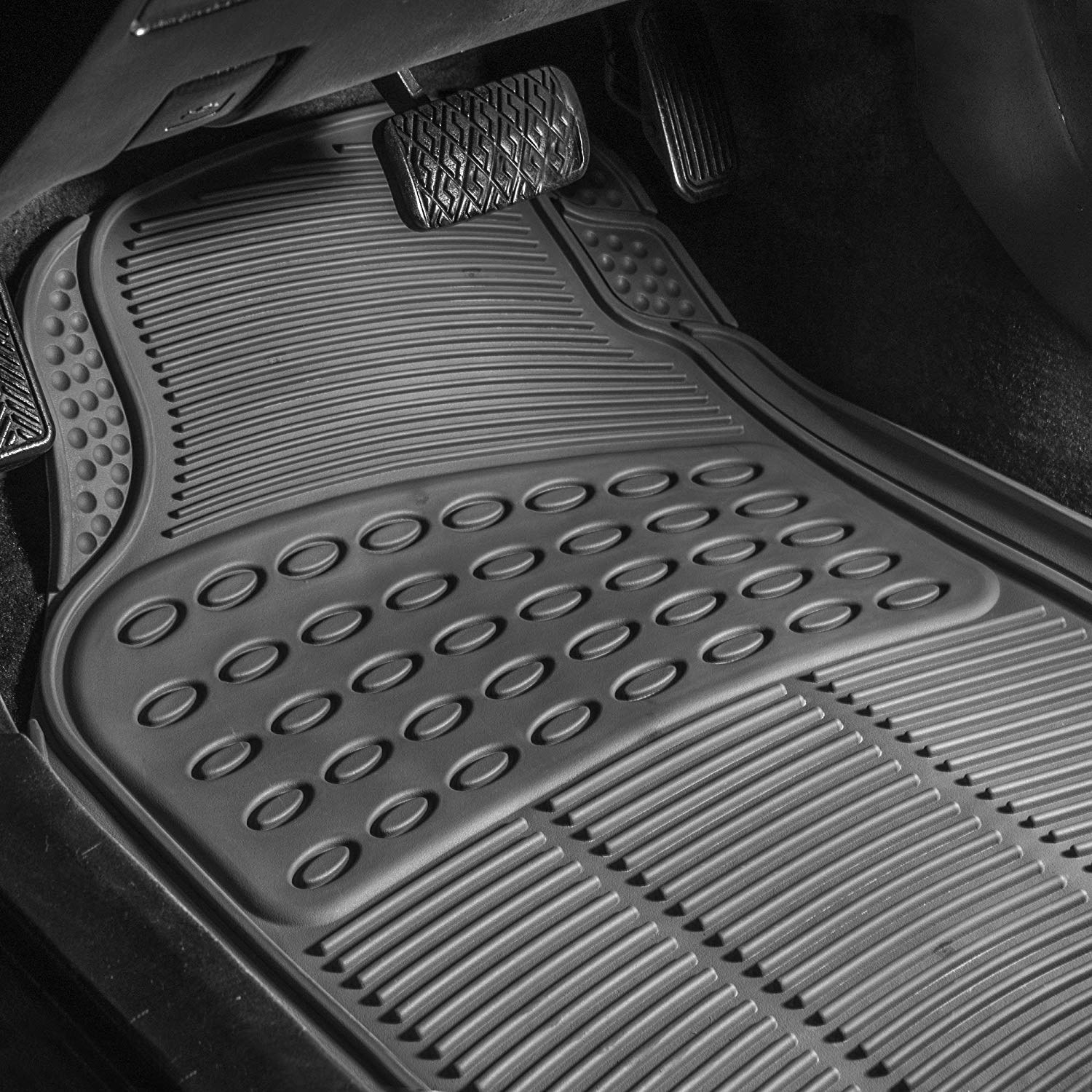 inside of a car with a gray floor mat