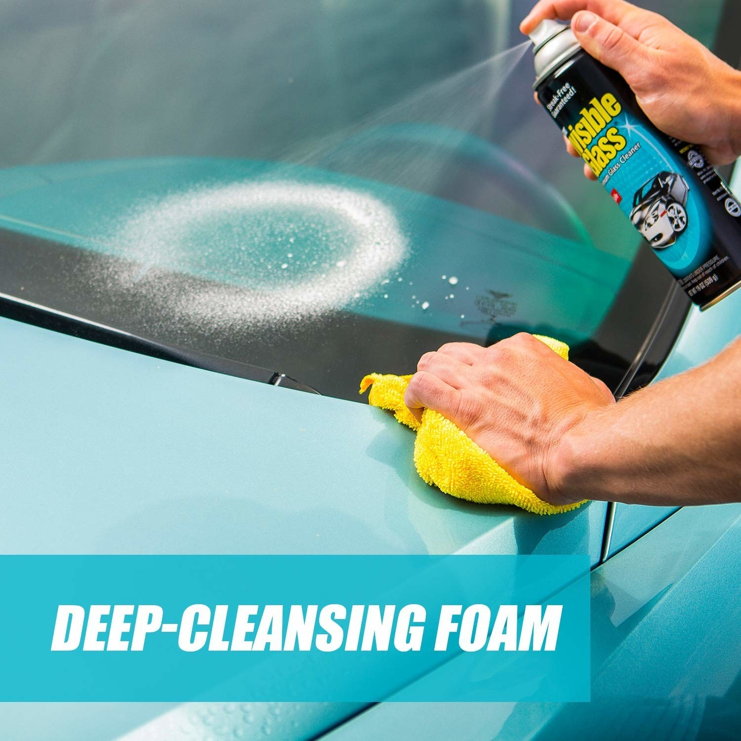spraying the cleanser on a windshield