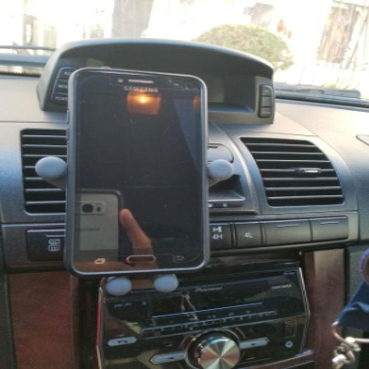 the phone holder with a phone in it