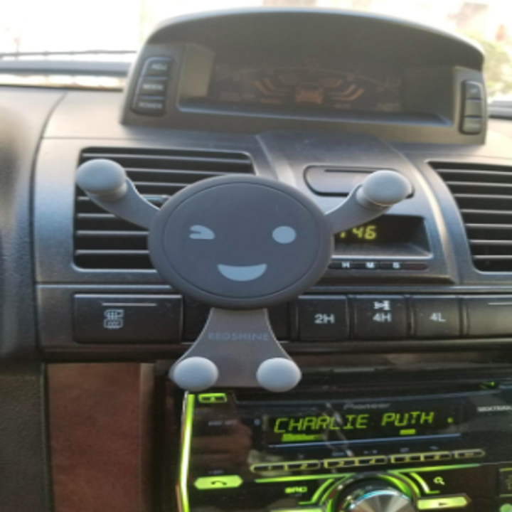 the person-shaped phone holder attached to a car vent