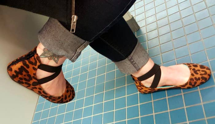 A customer review photo of a person wearing the ballerina flats in leopard print