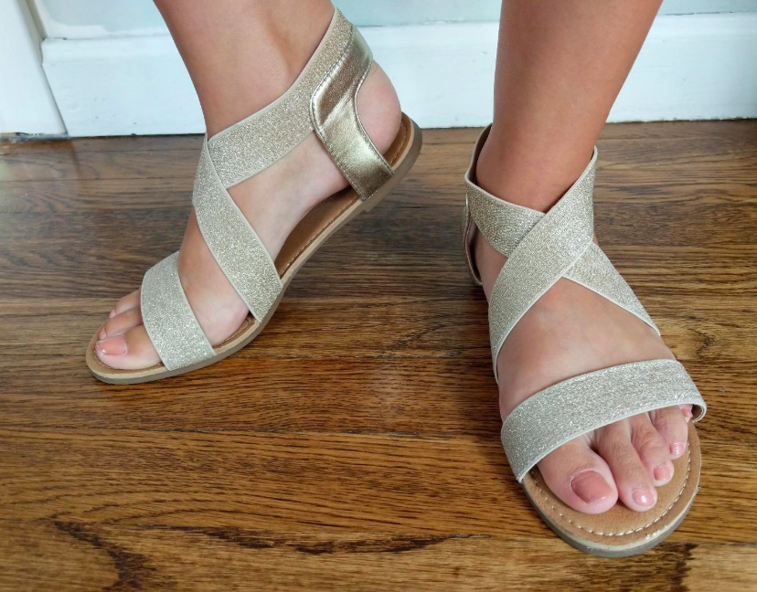 A customer review photo of a person wearing the ankle-strap sandals.