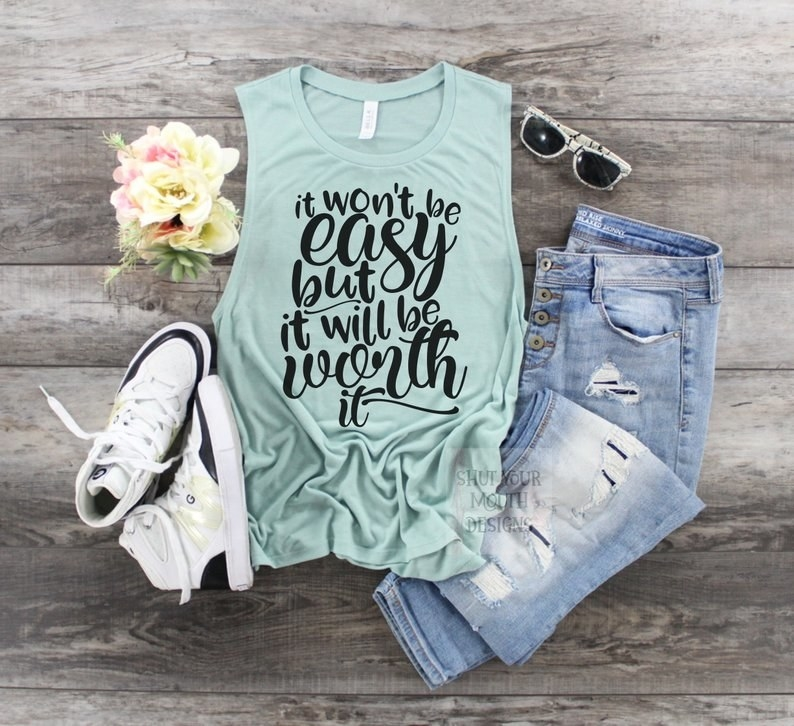 """a light blue tank top with the words """"it won't be easy but it will be worth it"""" on it blue font"""