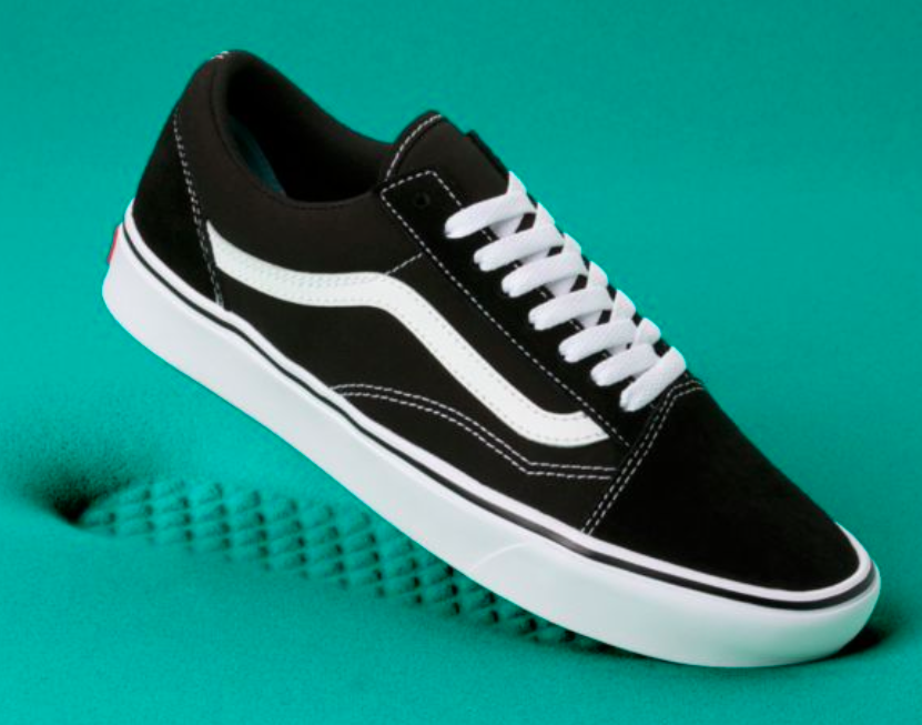 A photo of the ComfyCush Vans in classic black and white.